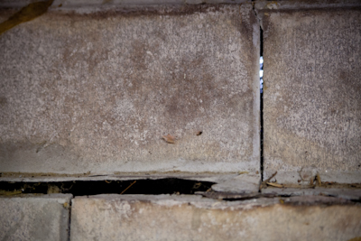 image of a foundation with a crack so wide you see daylight inside